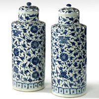 A fine pair of 19th Century blue and white Chinese vases with covers. Thumbnail 1