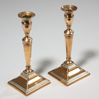 A fine pair of Georgian period square based brass candlesticks. Thumbnail 1