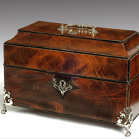 A fine Chippendale period mahogany caddy retaining its original silver canisters. Thumbnail 1