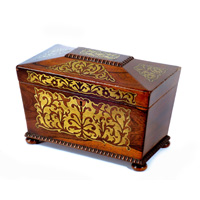 A Regency period rosewood veneered sarcophagus shaped tea caddy. Thumbnail 1