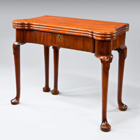 A George I period mahogany triple top games table. Thumbnail 1