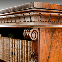 A fine pair of William IV period carved rosewood open bookcases. Thumbnail 1