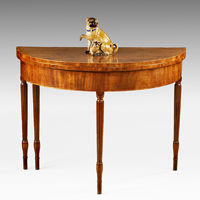 A Sheraton period mahogany demi-lune card table of unusually large proportions. Thumbnail 1