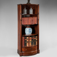 A rare Regency period mahogany open fronted bow shaped bookcase. Thumbnail 1