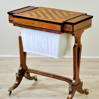 A Regency period rosewood veneered and brass inlaid games table. Thumbnail 1