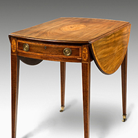 A Sheraton period mahogany oval pembroke table. Thumbnail 1