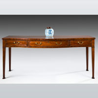 A fine Sheraton period mahogany serpentine fronted serving table. Thumbnail 1