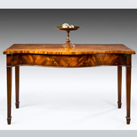 A Sheraton period mahogany serpentine fronted serving table. Thumbnail 1