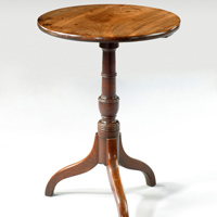 An antique low Georgian tripod table.