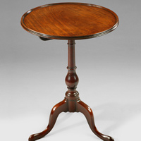 A George III period mahogany dished top tripod table. Thumbnail 1