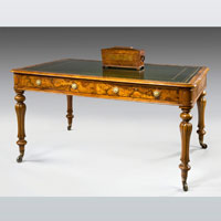 A fine mid 19th Century walnut veneered 4 drawer writing table. Thumbnail 1
