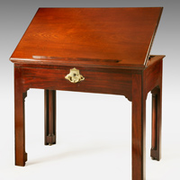 A Chippendale period mahogany lift top architect's table. Thumbnail 1