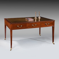 A Sheraton period mahogany six drawer writing table. Thumbnail 1