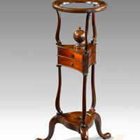 An antique George II wig stand.