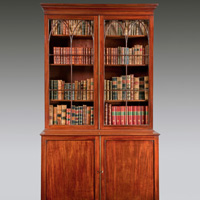 A George III period mahogany 2 door cupboard base bookcase. Thumbnail 1