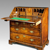 A beautifully patinated Queen Anne period walnut veneered bureau. Thumbnail 1