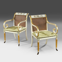 An antique pair of Regency style armchairs.