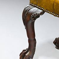 A late 19th Century carved mahogany stool. Thumbnail 1