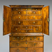 A well patinated Queen Anne period walnut veneered cabinet on chest. Thumbnail 1