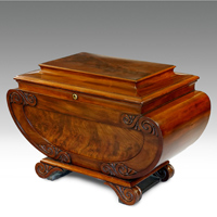 A fine Regency period sarcophagus shaped wine cooler veneered in highly figured mahogany. Thumbnail 1