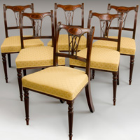 An elegant set of six Sheraton period mahogany dining chairs. Thumbnail 1
