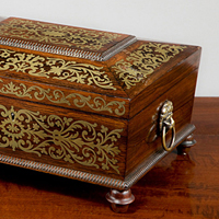 A Regency period rosewood veneered and brass inlaid jewellery box. Thumbnail 1