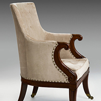 A fine pair of Regency period carved mahogany bergere armchairs. Thumbnail 1