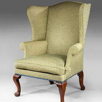 A George I period walnut wing armchair. Thumbnail 1