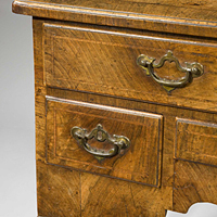 A beautifully patinated Queen Anne period walnut veneered lowboy. Thumbnail 1