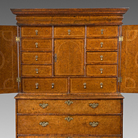 A rare Queen Anne period burr yew veneered cabinet on chest. Thumbnail 1