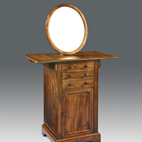 An unusual gentleman's Regency period mahogany dressing table. Thumbnail 1