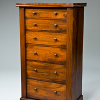 A Regency period rosewood veneered wellington chest. Thumbnail 1