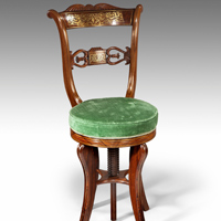 An unusual Regency period rosewood and brass inlaid music chair. Thumbnail 1