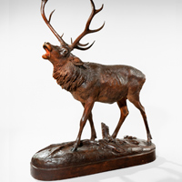 An antique carved limewood stag.