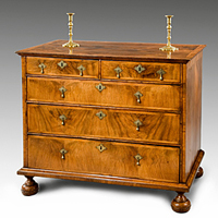 A Queen Anne period walnut veneered chest. Thumbnail 1