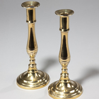 A fine pair of Regency period round base brass candlesticks. Thumbnail 1