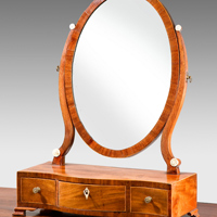 A Sheraton period mahogany serpentine fronted dressing table mirror. Thumbnail 1