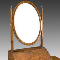 A fine Irish Sheraton revival mahogany oval toilet mirror. Thumbnail 1