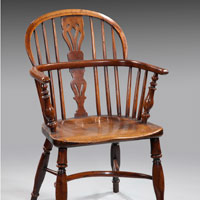 An 18th Century yew wood windsor armchair. Thumbnail 1