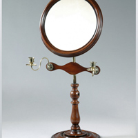 A William IV period mahogany shaving mirror. Thumbnail 1