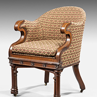 A pair of Gothic revival oak armchairs. Thumbnail 1