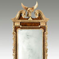 A fine George II period walnut and parcel gilt mirror of unusually large proportions. Thumbnail 1