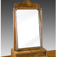 A Queen Anne period walnut veneered dressing mirror. Thumbnail 1