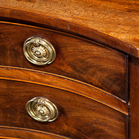 An elegant Sheraton period mahogany veneered serpentine chest. Thumbnail 1