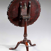 A well patinated Chippendale period piecrust tripod table. Thumbnail 1