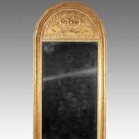 An antique mirror from the  19th Century in giltwood.