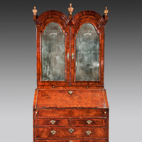 A William and Mary period walnut veneered double domed bureau bookcase. Thumbnail 1