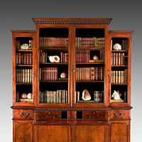 A handsome Chippendale period mahogany breakfront bookcase. Thumbnail 1