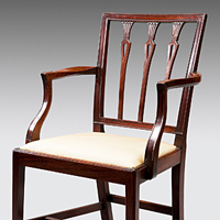 A well patinated set of twelve (10+2) Sheraton period mahogany dining chairs. Thumbnail 1