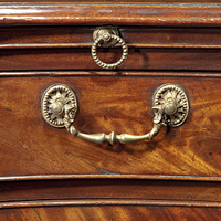 A fine Chippendale period mahogany veneered serpentine commode.  Thumbnail 1